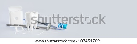 White healthy tooth, different tools for dental care. Dental background. #1074517091