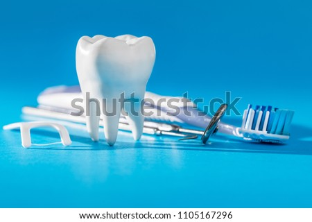White healthy tooth, different tools for dental care. Dental background. #1105167296