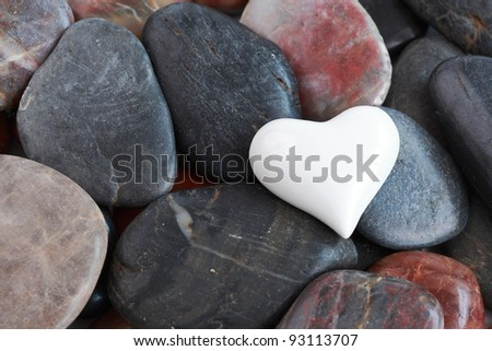 White heart heart surrounded by natural stones