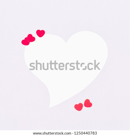 White heart on a pastel grey background. Valentine day concept. Trendy minimalistic flat lay design background. Square #1250440783