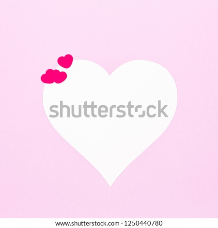 White heart on a pastel pink background. Valentine day concept. Trendy design background. Square #1250440780