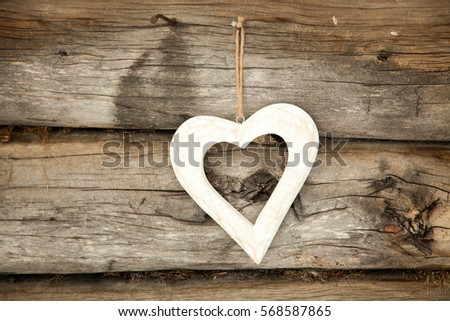 White heart on a rustic wooden background. St. Valentine's Day #568587865