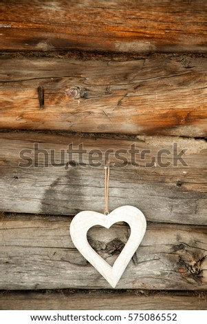 White heart on a rustic wooden background. St. Valentine's Day #575086552