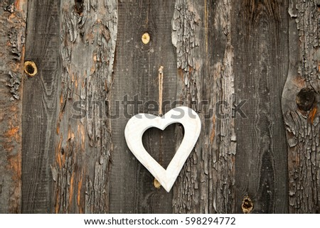 White heart on a rustic wooden background. St. Valentine's Day #598294772