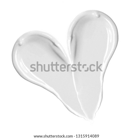 White Heart Shape Cosmetic BB Cream Isolated on White Background. Cosmetics Makeup Smudge. Top View Lip Gloss Lipstick Swatches. Grooming Products. Liquid Foundation Strokes. Skin Tone CC Cream Smear