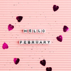 White HELLO FEBRUARY beads message typography