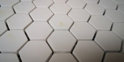 white hex tiles close up