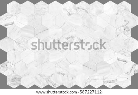 white hexagon marble tile wall...