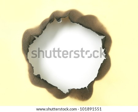 White hole on burnt paper