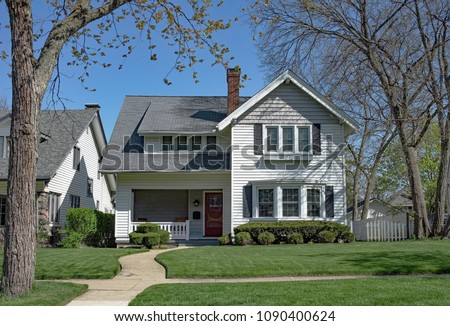 White Home with Curved Walk