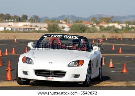 white Honda sports car competing in auto cross race