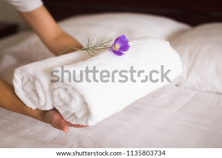 white hotel bed sheets and towel set. maid cleaning bed. Room service.