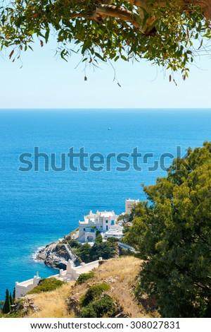 White hotels on the blue sea side on Ios island, Greece
