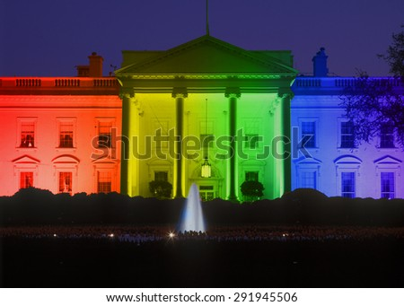 White House in evening, Washington, DC with Rainbow Flag projected onto it, symbolizing screen court decision for the right of LGBT (Lesbians, Gays, Bisexuals and Trans-genders to marry).