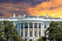 White House on deep red sunset background