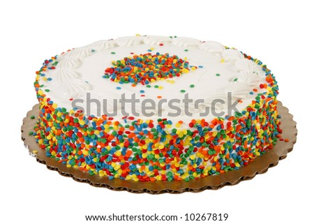 White icing sprinkle decorated cake on white background.