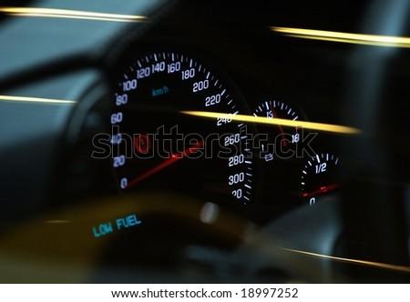 white  illumninated car tachometer