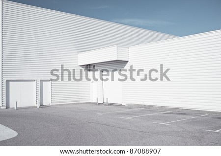 White industrial architecture - Outdoor view of a white faded store architecture
