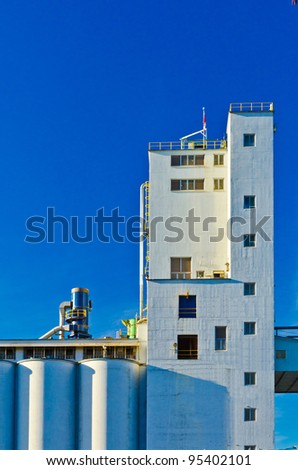 White Industrial Building over blue sky in Vancouver, Canada.