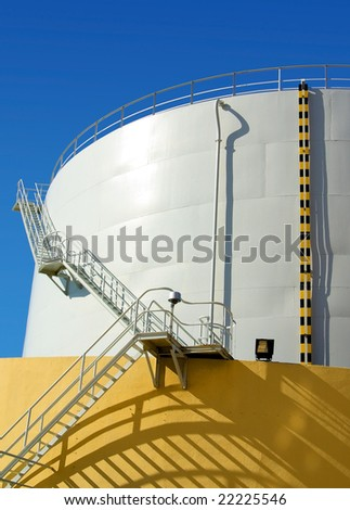 White industrial oil container with stairs in a refinery
