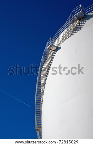 White industrial tank with stairs