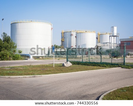 white industrial tanks in the industrial port of Oristano #744330556