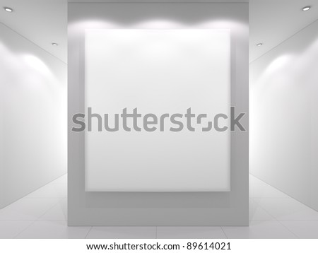 White interior with empty frame on a wall.