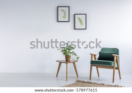 White interior with kale green chair, rug and small table #578977615
