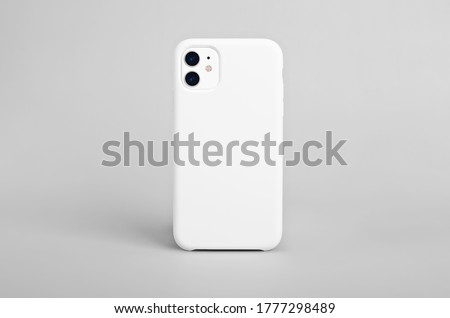 Photo of  White iPhone 11 isolated on gray background, phone case mock up, smart phone back view