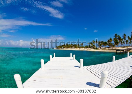 white jetty on tropical island, Belize.