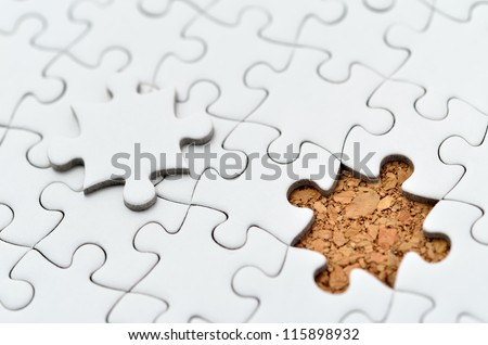 White jigsaw puzzle. (Mount in cork board)