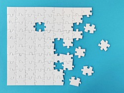 White jigsaw puzzle on blue background