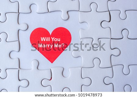 white jigsaw puzzle piece with Red heart and Will you Marry me? Wording. Love and Happy Valentine's day concepts #1019478973