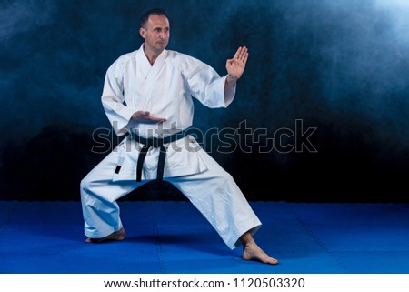 White Karate Fighter Isolated On Black with smoke effect