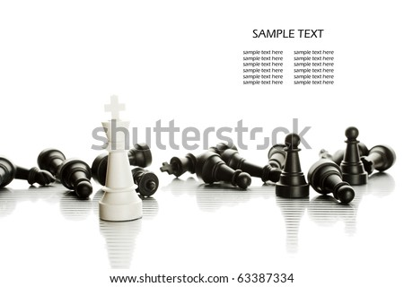 White King in the foreground against a background of black army chips. - stock photo