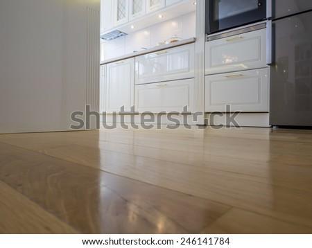 White kitchen and parquet floor