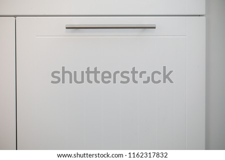 White kitchen cabinets with metal pulls or knobs on the doors Сток-фото ©