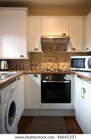 White kitchen in small UK Home vertical view
