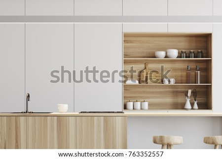 White kitchen interior with a wooden floor, a light wooden bar and white cupboards in the background. Close up 3d rendering mock up Stock photo ©