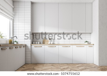 White kitchen interior with a wooden floor, white countertops and a large window. 3d rendering mock up