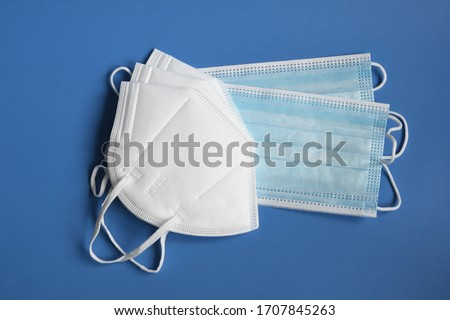 white KN95 or N95 mask with antiviral medical mask for protection against coronavirus. Surgical protective mask. prevention of the spread of virus and pandemic COVID-19.