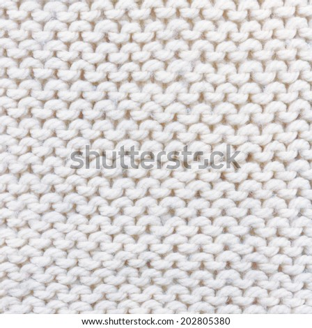 white knitted background. texture knitted.  handmade work.