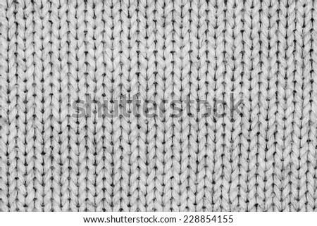 White knitting wool texture closeup photo background.