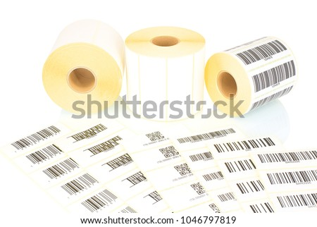 White label rolls and printed barcodes isolated on white background with shadow reflection. White reels of labels for printers. Labels for direct thermal or thermal transfer printing. Barcode samples.