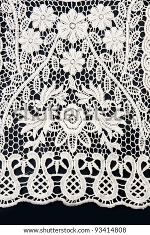 white lace on a black background