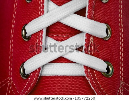 White lace on red sneakers close up