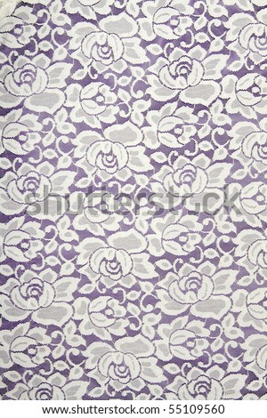 White lace with floral pattern on black background