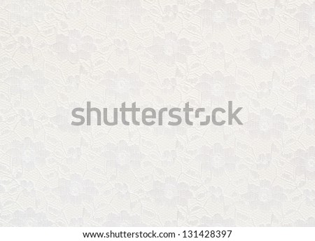 White lace with small flowers on the white background
