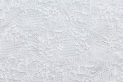 White lace with small flowers on the white background. No any trademark or restrict matter in this photo.