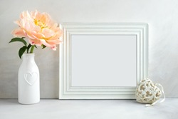 White landscape frame mock up with a peony & heart beside the frame, overlay your quote, promotion, headline, or design, great for small businesses, lifestyle bloggers and social media campaigns